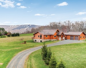 Now on the market from Halter Associates Realty is this custom-designed log home in Fleischmanns on five acres with a quintessential Catskill Mountain view that includes the slopes of Belleayre Mountain Ski Center. The property is easily accessible to all the natural beauty, recreation, arts, culture, and cuisine that make the Hudson Valley and Catskill Mountain regions so desirable.