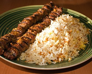 Beef Koobideh made on a grill, served with a Persian style basmati rice.