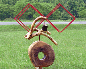 """Bat on a Unicycle by John Byer and Red Cubes by Ze'ev Willy Neumann"""" at Catskill Interpretive Center Art Park. Photo by Dave Channon"""