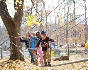 K-1 students climb the obstacle course during Forest Mondays at Randolph School.