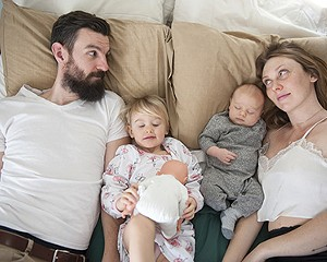 Kyle Needham and Alexis Arvidson Needham in the family bed with Layla and Bowie.