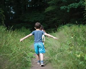 Children enjoy walking in nature.
