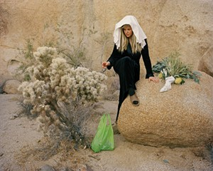 "Mollie McKinley, Cholla Bag and Toe Hole Stocking, Reaching, 2018, archival inkjet print, part of the ""Time Travelers"" exhibit at the Dorsky Museum this summer."