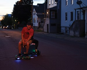 Justin and Brittany Quinones take a night ride on their mobile cooler.