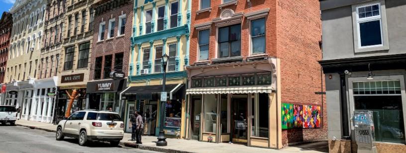 The exterior of Queen City 15 gallery.