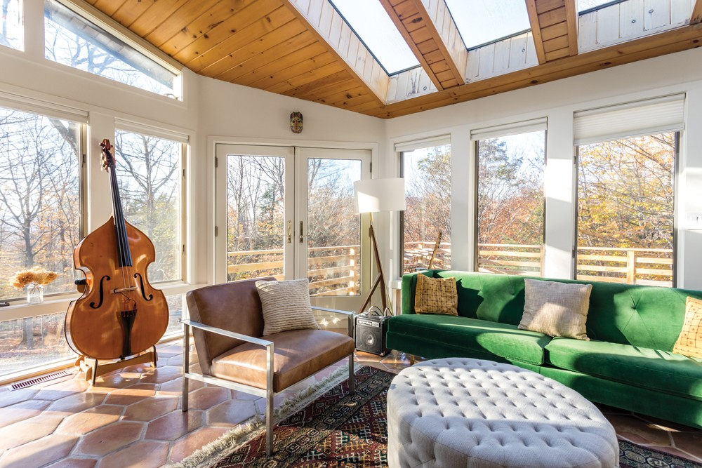 The music room of Sree Kant and Annie Duflo's house is flooded with light. Once a sun porch, the west-facing room enjoys views of the nearby Catskill Mountains and lush winter sunsets. It's the perfect place to practice an - instrument—a favorite pastime for both Duflo, who plays the piano, and Kant, who is learning the bass. - PHOTOS BY WINONA BARTON-BALLENTINE