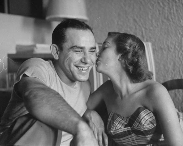 Yogi Berra gets a kiss from his wife Carmen in 1949. - PHOTO BY GEORGE SILK/THE LIFE PICTURE COLLECTION/GETTY