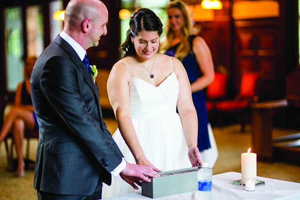 Evelien and Joe perform a Love Letter & Beer Box ceremony at their wedding. - DENNIS PIKE