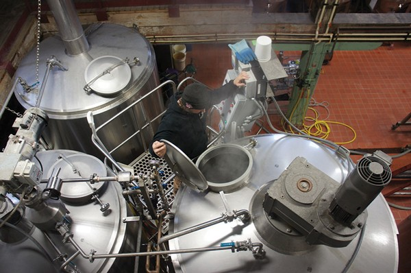Christopher Basso inspects the brewing operations at Newburgh Brewing Company.