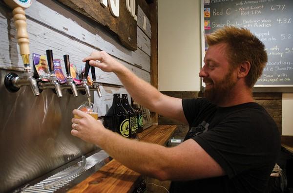 Adam Watson in the tasting room at Sloop Brewing in Elizaville.