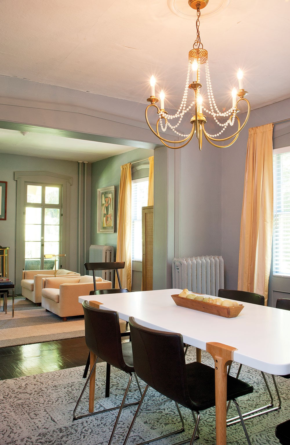The home's sitting and dining rooms. Sexton painted all the floors by hand, crawling through the house with a two-wedge paint brush. - DEBORAH DEGRAFFENREID