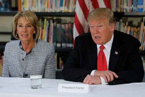 President Donald Trump and Education Secretary Betsy DeVos meet with parents and teachers at Saint Andrew Catholic Church in Orlando on March 3. - JONATHAN ERNST (REUTERS)