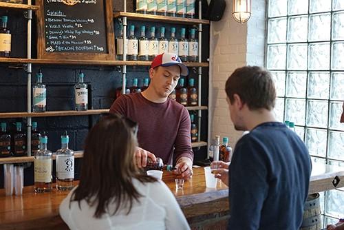 Mark Pisanelli tending bar at Denning's Point Distillery - JOHN GARAY
