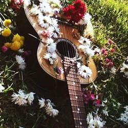 4fd80c03_guitar_flowers.jpg