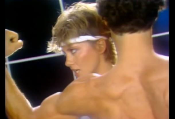"Video still from Olivia Newton John's ""Physical."""