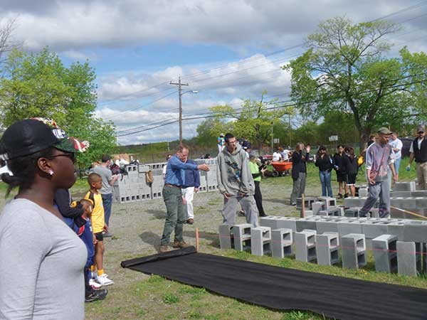 Volunteers build the City of Newburgh's community garden at the Armory Unity Center. - VIRGINIA KASINKI