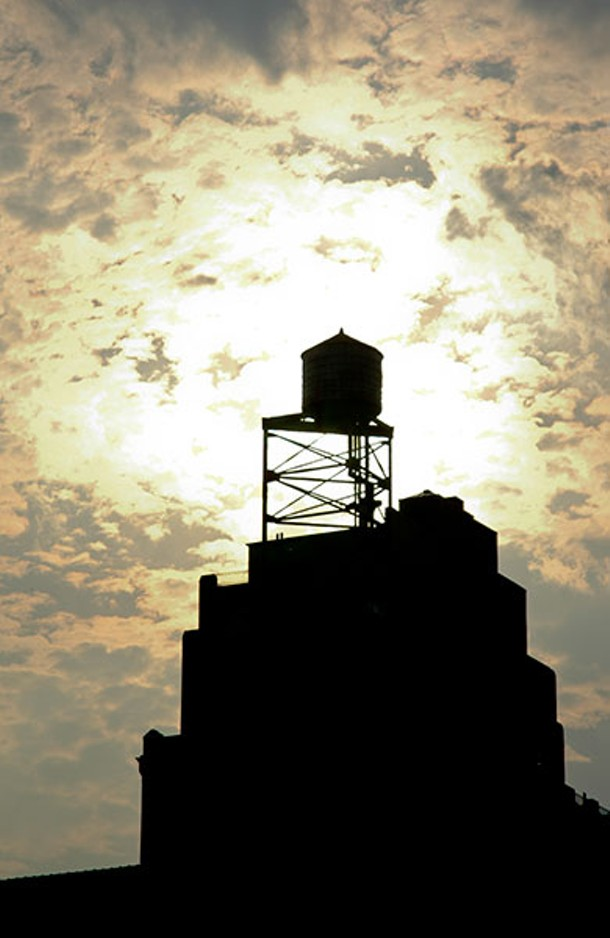 Water tower in silhouette, West 100th Street and Columbus Avenue, 2006.