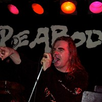 Saxon performing on April 8, 2002