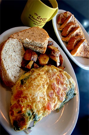A fluffy omelet, toast, and home fries are joined by French toast and a cup o' joe for a diner-style breakfast quintet. - WALTER NOVAK
