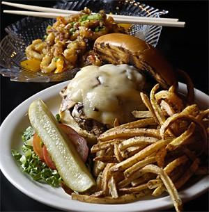 A juicy burger, fresh-cut fries, and tender calamari, washed down with a cold Pabst. - WALTER NOVAK
