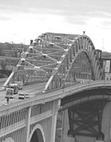 WALTER  NOVAK - A man either contemplates suicide or is looking for his - lost dog atop the Detroit-Superior Bridge Tuesday.