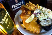 A nip o' whiskey and a pint o' Guinness are fine companions for Flannery's fish 'n' chips. - WALTER NOVAK