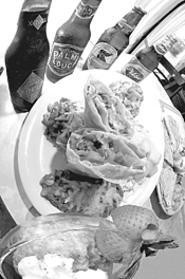 A vegetarian chimichanga with all the fixin's goes great with oh, four beers. - WALTER  NOVAK