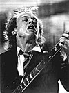 AC/DC's Angus Young makes a guitar face for      photographer Walter Novak.