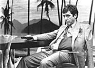 Al Pacino introduces some very bad men to his little friend - in Scarface, one of the many blood-saturated flicks - in Bullets Over Hollywood.