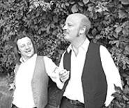 Allen Branstein (left) and Andrew Narten play dimwit hit - men in Charentons Absurdity in the Streets.