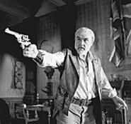 Allen Quatermain (Sean Connery) shoots at bad guys.