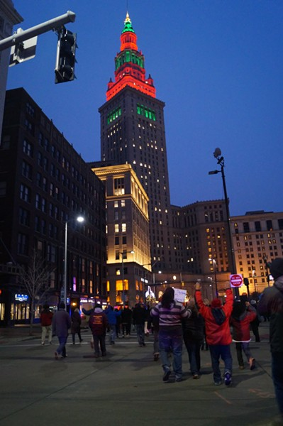Terminal Tower decked out in Holiday green and red as protesters return to the Square. - SAM ALLARD / SCENE