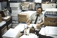 Boxed in: If you look hard, you'll find Office Space's Stephen Root buried there among all the TPS reports.