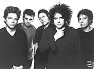 Boys do cry: Robert Smith (second from right) has - rediscovered his youthful vigor.