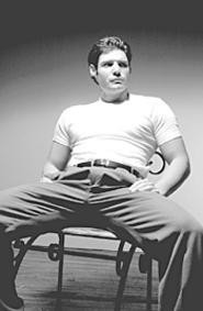 Brooding dude: Stanley contemplates life and stuff in - A Streetcar Named Desire.