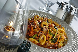 Calamari, sweet pepper, and crisp carrots mingle in a seductively spicy glaze. - WALTER NOVAK