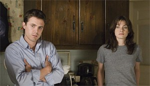 Casey Affleck and Michelle Monaghan react to Kenny Lofton's two-run homer.