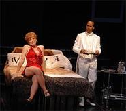 Charity (MaryAnn Black) displays her Lucille Ball-like charms for Vittorio Vidal (Jim Weaver).