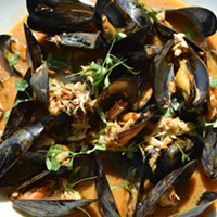 The 10 Best Sriracha Dishes Cleveland Has to Offer Chef Dante Boccuzzi has brought his experience in Hong Kong to his mussel dish at DBA in Akon and guess what? It is loaded with Sriracha. Cooked in a wok, the mussels are tossed with spicey crab  soy, garlic, ginger,lime juice, cilantro, and engulfed in Sriracha. Dante Boccuzzi is located at 21 Furnace St, Akron. Call 330-375-5050 or visit restaurantdante.us for more information. Photo Courtesy of BSpot