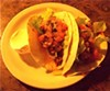 """Chipotle Pork Tacos ($7), <a href=""""parkviewniteclub.com"""">Parkview Nite Club, Detroit Shoreway</a> Dos tacos stuffed with in-house smoked pork and topped with hot salsa, honey chipotle and cheddar cheese."""