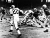 "Cleveland Browns vs. Pittsburgh Steelers- 1955  <p>Final Score- Cleveland 41: Steelers 14  <p>""Cleveland Browns defensive back Ken Konz (#22) scores a touchdown from the 15-yard line after intercepting a pass from Pittsburgh Steelers quarterback Jim Finks. Browns #72 John Kissell and #82 Carlton Massey block Steelers Frank Varrichione (#74). Also pictured is Browns #70 Don Colo. The Browns won the game 41-14, to improve to a 7-2 record for the 1955 season."""