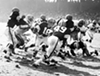 "Cleveland Browns vs. Pittsburgh Steelers- 1960  ""Pictured here left-to-right are Browns #32 Jim Brown, Steelers #70 Ernie Stautner, Browns #56 John Morrow, Browns #16 Milt Plum, Browns #49 Bobby Mitchell, Browns #64 Jim Ray Smith, Steelers #82 George Tarasovic, an unidentifiable Browns player, and Steelers #46 Fred Williamson. Browns won the game 28-20, to improve their record to 2-0 for the 1960 season."""
