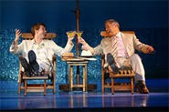 D. B. Bonds (left) and Tom Hewitt toast their own deviousness in Dirty Rotten Scoundrels.