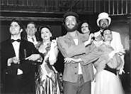 Dan Folino (center) as Che Guevara, with Evita cast members.