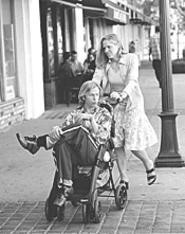 David Spade gets a little push from Mary McCormack in Dickie Roberts.
