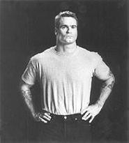 Even his tattoos are tough: Henry Rollins puts on a grumpy face.