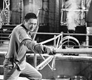 Fat chance: Hong Kong's Cary Grant/John Wayne - finally gets to show his stuff -- kind of.