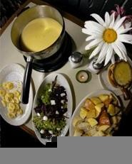 Feeling cheesy? Le Oui Oui's fondue dinners can help. - WALTER  NOVAK