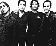 Four white guys (Jenkins, second from left) who play rock music. Scared yet?