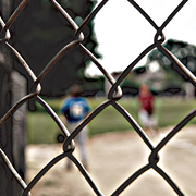 Free Base: A Neighborhood Reacts after Violence Interrupts West Denison Little League's Summer Games